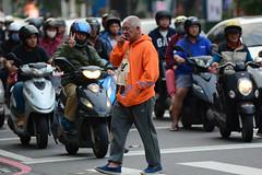 Double Fumes (Bob Hawley) Tags: asia taiwan kaohsiung nikond7100 nikon80200mmf28af cities streetscenes people traffic vehicles motorbikes motorcycles scooters crosswalks men walking smoking pedestrians