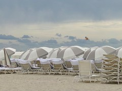South Beach Chairs: Miami, FL (John.Johnson.15) Tags: miami beach florida south sun fun vacation stormy skies party people walking sand clouds sunlight glow chairs tourist yellow tan white foliage grass tall