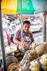 Man & Durian (Tiziana de Martino) Tags: durian fruit people market asia bangkok chinatown work thai travel destination