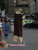 Too close to the police car, that one is.  Yeesssssss (Steve Taylor (Photography)) Tags: yoda hat indian levitating gkn police car trafalgarsquare bucket taxi charingcross station floating oneway costume brown green pink cloth uk gb england greatbritain unitedkingdom london weird strange