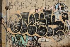 OMEK (TheGraffitiHunters) Tags: graffiti graff spray paint street art colorful nj new jersey trackside omek cement wall