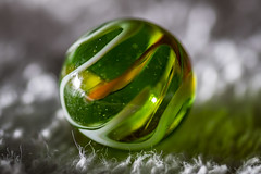 Swirled (Kevin Tataryn) Tags: marble toy game green closeup nikon d500 100mm tokina offcameraflash sundaylights
