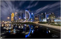 Doha Cityscape (Shans Photografia) Tags: city cityscape longexposure sky clouds water reflection doha qatar
