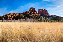 cathedral rock (Port View) Tags: fujixe3 sedona arizona az usa crescentmoonranch redrockcrossing 2018 winter field grass gold golden rock red blue sky sun sunlight color colour landscape cathedralrock