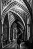 sous les arches fleuries (Fab. A) Tags: monochrome blackandwhite noiretblanc architecture église church perspective people street canonm 22mm
