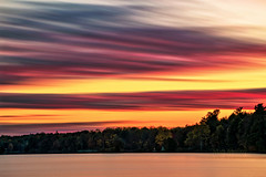 Soft Lines (Matt Molloy) Tags: mattmolloy timelapse photography timestack photostack movement motion colourful sky pink red orange clouds trails soft lines water reflection trees haskinspoint littlecranberrylake seeleysbay ontario canada landscape nature countryside lovelife