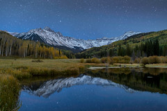 Mount Sneffels Under the Stars (NickSouvall) Tags: mount sneffels wild wilderness mountain range peak snow capped sharp dramatic beaver pond water lake reflection stars star night dark nightscape astro astrophotography blue hour moon light moonlit fall yellow gold aspen forest autumn foliage color warm tones san juan mountains colorado colorful nature photography landscape photographer picture image photo explore discover hike