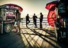 On the Board Walk (tritranla) Tags: sun urban ocean candid shadow people losangeles streetphotography woman city beach california men