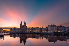 Central Amsterdam during sunrise (tommyferraz) Tags: sunrise morning early golden hour sky clouds cloud pink sun rise sunset amsterdam central city cityscape landscape holland netherlands dutch