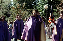 55-378 (ndpa / s. lundeen, archivist) Tags: nick dewolf nickdewolf photographbynickdewolf 1973 1974 1970s color 35mm film 55 reel55 boston massachusetts ma columbusday parade columbusdayparade woman women cape capes robe robes glasses eyeglasses flag americanflag costume costumes costumed uniform uniforms uniformed october fall autumn