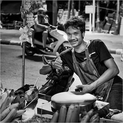 Like (John Riper) Tags: johnriper street photography straatfotografie square vierkant bw black white zwartwit mono monochrome phuket thailand candid john riper xt2 fujifilm like smile moped scooter food stall bananas man night xf35mm f2