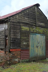 The old barn. (salvtecmarine) Tags: metal sheet corrugated decaying decay rural fujifilm fuji tree loch down falling glass broken garage she'd scotland scottish overgrown wooden wood rotten rusty rust barn old