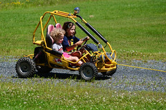 Getting Pulled for a Ride (Vegan Butterfly) Tags: outside outdoor summer fun kids children kid child dune buggy friends together homeschool homeschooling ride