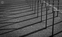Long Shadows (dlerps) Tags: de daniellerps deutschland europe germany hamburg hamburgerhafen harbor lerps northerngermany seaport sigma sony sonyalpha sonyalphaa77 hafen ice lerpsphotography snow winter shadow shadows bw blackwhite monochrome architecture pattern bicyclestands