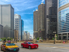 Downtown Chicago.... (Kevin Povenz Thanks for all the views and comments) Tags: 2015 june kevinpovenz chicago illinios downtown street streetphotography red yellow blue building buildings car auto automobile canon60d drive people tall skyscrapers