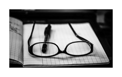 Lack of inspiration (gwennscott) Tags: writing glasses pen pencil notebook blackwhite monochrome
