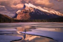 The man and the mountain (Luc Stadnik) Tags: lake mountain reflection goldenhour banff alberta canada photographer
