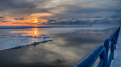 Sunset on ice #1 (tquist24) Tags: hdr lakemichigan michigan nikon nikond5300 stjoseph blue clouds cold evening frozen geotagged ice lake orange pier reflection reflections sky snow sun sunset water winter saintjoseph unitedstates