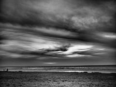A break in the clouds. (explored) (isaacullah) Tags: grey monochrome mono blackandwhite black white beach coast coastal shore shining sun sunset clouds landscape sand sandiego southern california socal winter cloudy fog