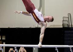 One-handed move (RPahre) Tags: gymnastics huffhall huff champaign illinois arizonastateuniversity arizonastate zekehowland bars parallelbars
