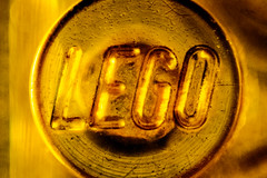 leguid gold (fe2cruz) Tags: lessthananinch macromondays macrocloseup macro tamron adaptall2 sp 90mm f25 α7r a7r tube extension reversering reverselens porst 5017 stackedlens lego stud print gold yellow translucent text maximacro 21magnification