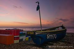 Sea Pirate & the Sunrise (Neil Clark) Tags: dawn daybreak englishchannel goringbeach greatbritain manualfocus pentaxa2450mmf40 sonynex6 westsussex worthing legacylens shingle fishingboat