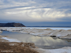 Winter Reflections (JamesEyeViewPhotography) Tags: lake michigan sky clouds snow sand beach water reflections ice greatlakes lakemichigan northernmichigan landscape nature sleepingbeardunesnationallakeshore sunset february jameseyeviewphotography