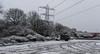 The Lonely Car Park (M C Smith) Tags: snowing pentax k3 van tracks pylon trees powerlines petrol station lamps dark grey white black orange