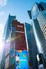 Times Square (MikePScott) Tags: architecturalfeatures banner billboard buildings builtenvironment camera clouds featureslandmarks flag logo newyork newyorkcity nikon28300mmf3556 nikond800 sign sky skyscraper timessquare usa