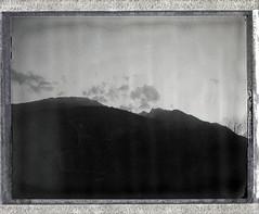 Spring Sunset, Goop (sycamoretrees) Tags: analog automatic100 clouds film fp3000b fp3000b201503 fuji goop instantfilm landcamera marianrainerharbach model100 mountain negative packfilm polaroid sky type100