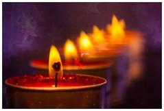 Tea light twist (EddieAC) Tags: candle candlelight flame star blur bokeh macro glitter flash