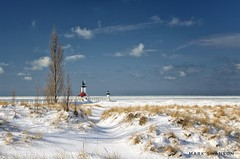 Winter White (mswan777) Tags: seascape shore coast beach dune grass scenic outdoor nature winter cold cloud nikon d5100 nikkor 1855mm ice lighthouse pier horizon