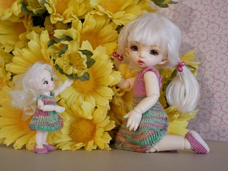 Yellow - Thumbelina and tiny flower fairy Rose are curious about the yellow flowers in the house. Rose finds them quite confusing now while the freezing mid winter wind blows.