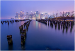 Manhattan from Brooklyn Bridge Park (Shaw Horton) Tags: newyorkcity newyork ny nyc brooklyn brooklynbridgepark park bluehour manhattan downtownmanhattan downtown pier cityscape city longexposure pillars river eastriver tokina1116mm tokina purple blue mist fog