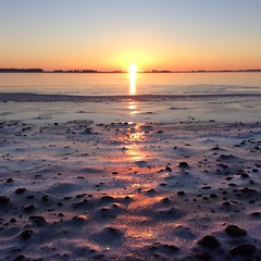 Moment of Silence, (twistling) Tags: frozenbeach frozensea frozenwater water stone yellow nature clouds sunrise sunset sun ocean seashore sea beach cold white frozen icy ice winter