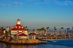 Long Beach Sunset (MonicaIva Photography) Tags: california westcoast rocks water red building ocean coast boardwalk sunset usa longbeach