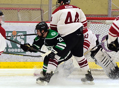 All about leverage... (R.A. Killmer) Tags: sru green white hockey acha ice rock slippery university net goal leverage check black stick puck action