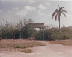 Northeast Gate, Guantanamo Bay, Cuba 1988 (1811/1812 USMC) Tags: guantanamo gate cuba 1988 palmtree sky carribean navy base marine marines usmc