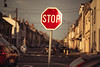 Make a stop at sunset (Lux Obscura) Tags: traffic sign sunset street goldenlight winter february depthoffield dof f12 fujifilm underexposure