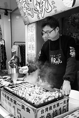 Filling (Go-tea 郭天) Tags: xiamen candid sea food cook cooking cooked preparation prepared preparing delicious chef young alone business shop duty busy filled fill filling shrips octopus cream portrait small glasses street urban city outside outdoor people bw bnw black white blackwhite blackandwhite monochrome naturallight natural light asia asian china chinese canon eos 100d 24mm prime cold warm hot smog smoke xiamenshi fujiansheng chine cn