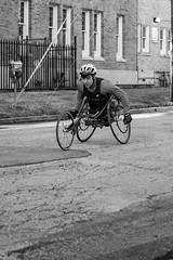 Wheelchair Athlete (burnt dirt) Tags: wheelchair bicycle bike athlete competition helmet uniform marathon halfmarathon 5k course race racer pedal wheel flag road street amputee prosthetic sunglasses glasses downtown town city bw blackandwhite fujifilm camera metro station busstation trainstation hero military xt1 streetphotography urban candid portrait documentary laugh smile winner medal sport vehicle outdoor people person abb5k houston texas houstonmarathon houstonhalfmarathon chevron man woman crank gloves sunny cold eagle catapult