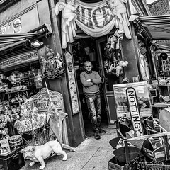 The Guardian of Wonderland (Mario Rasso) Tags: mariorasso street nikon d800 nikond800 nottinghill london londres uk unitedkingdom british market store person man blackandwhite blancoynegro blackwhite antiques retail portobello ngc
