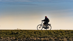 On Your Way On A Cold Winters Day (Alfred Grupstra) Tags: bicycle cycling outdoors sport men people nature recreationalpursuit healthylifestyle lifestyles action exercising males sunset oneperson leisureactivity summer cycle cyclist sky