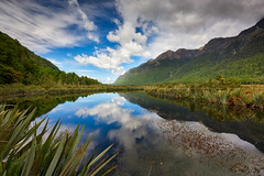 Mirror Lakes (Scintt) Tags: newzealand landscape surreal epic dramatic light glow vibrant lake pond tree river water reflection still peaceful quiet calm longexposure slowshutter mirror clouds sky sun patterns texture nature natural haida wideangle mountains clear tourism travel scintillation scintt jonchiangphotography symmetry blue