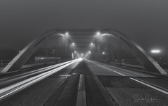 Foggy evening (Stefan Sellmer) Tags: lights longexposure bridge schleswigholstein germany blackwhite cityscape shadows kiel perspective fog deutschland de