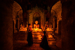 Monks praying, Mrauk U, Myanmar (ExposureDDD) Tags: kingdomofmrauku mrauku rakhine burmese shitethaungtemple htukkanthein temple burma pray monkspray myanmar unseenmyanmar unseenshot stuntshot greatshot greatphoto unseenpagoda pagodainmyanmar candle candlelight
