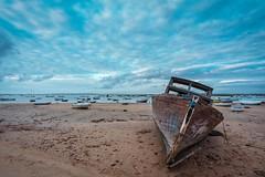 El Huérfano (Fede Duran) Tags: landscape boat fisherman clouds sky sony a7r3 wind beach sand andalucia cadiz spain wideangle tides