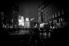 Busy London by Simon Hadleigh-Sparks (Simon Hadleigh-Sparks) Tags: christmas london city urban night dark angel street blackandwhite bw building car people architecture simonandhiscamera evening iconic lights monochrome outdoor roads vignette window road regentstreet piccadilly