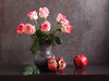 Red Goes With Everything (panga_ua) Tags: redgoeswitheverything flowers roses red greenleaves pomegranate broken seeds blackceramicvase ceramics