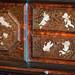 Antique cabinet detail with cherubs